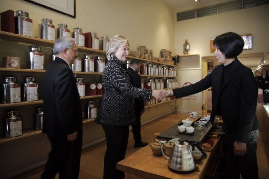 Hillary Clinton Sips At Red Blossom