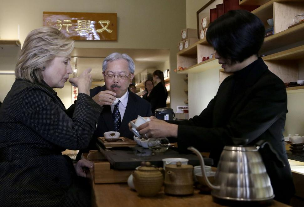 Hillary Clinton sips tea at Red Blossom Tea in Chinatown, San Francisco, CA.